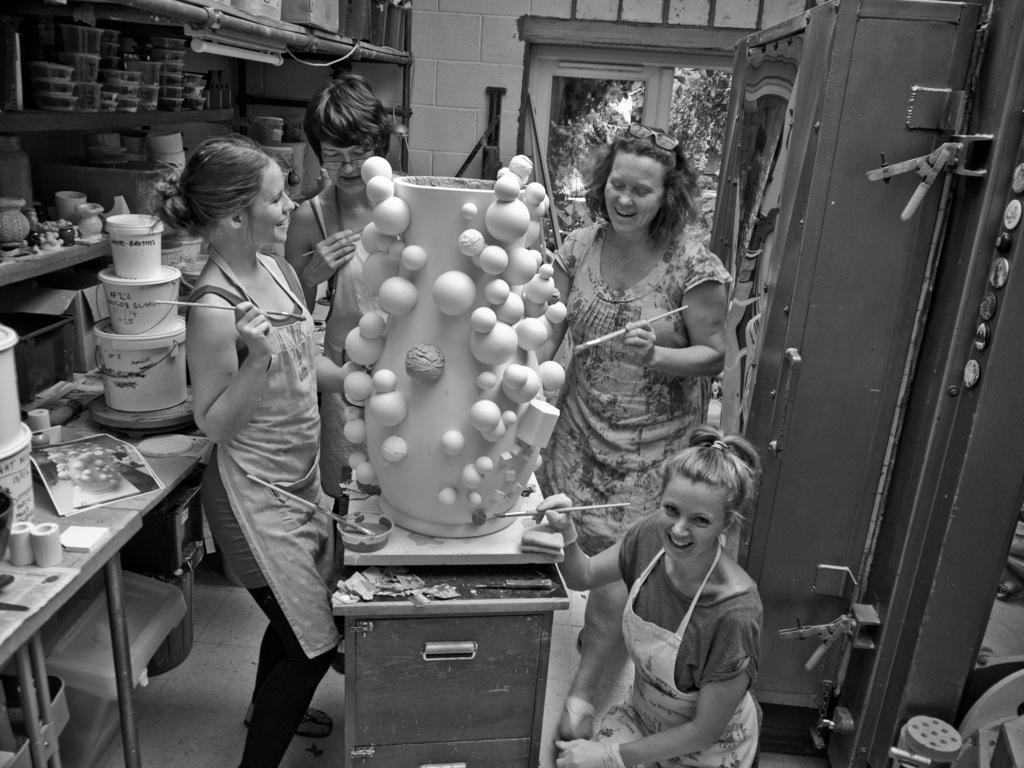 Team Balls Pond Studio applying glaze