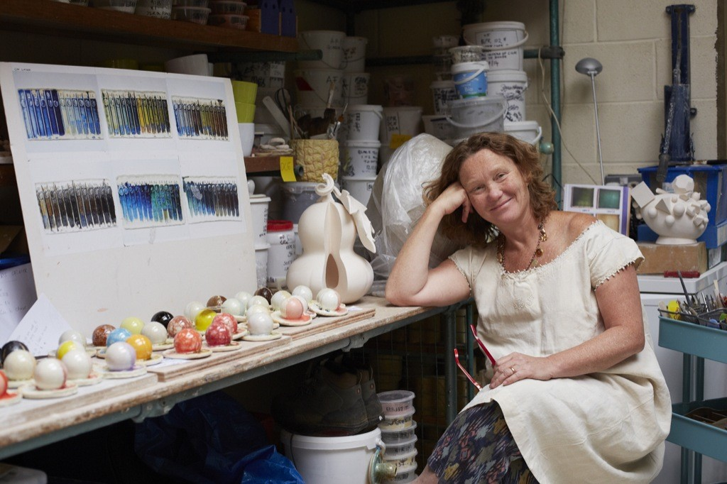 Kate in the studio with glazes